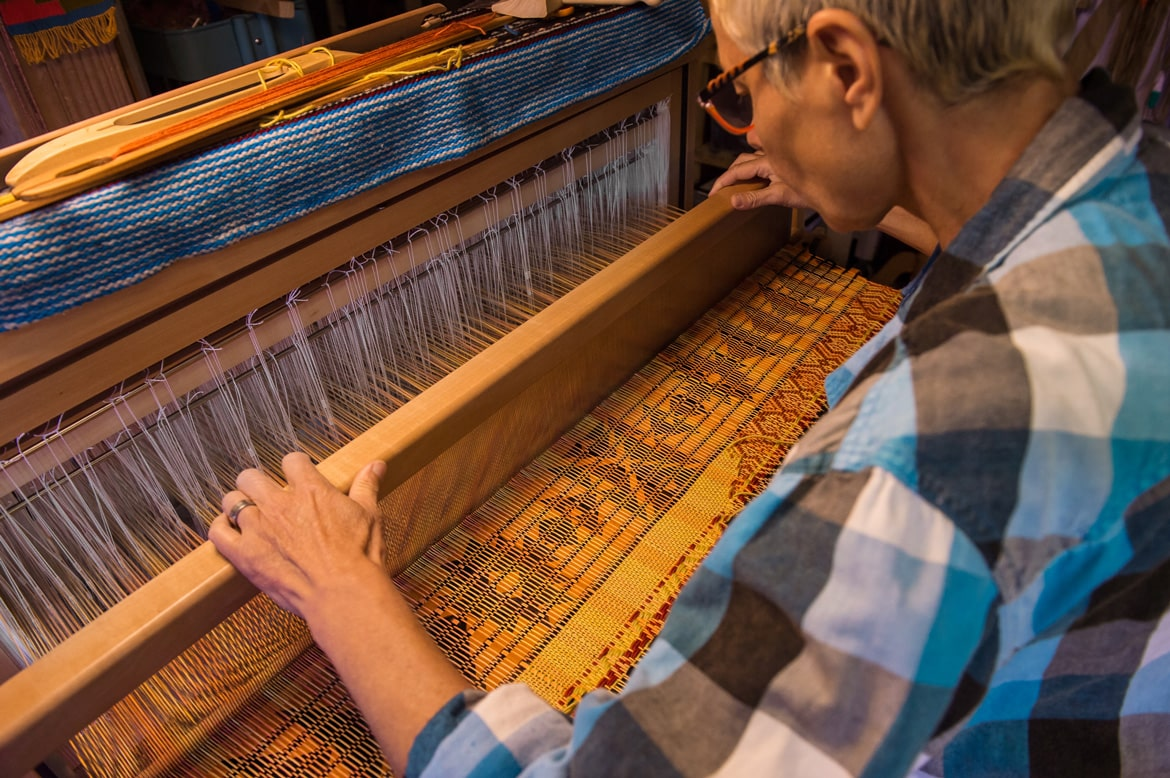 Picture of someone working at a loom.