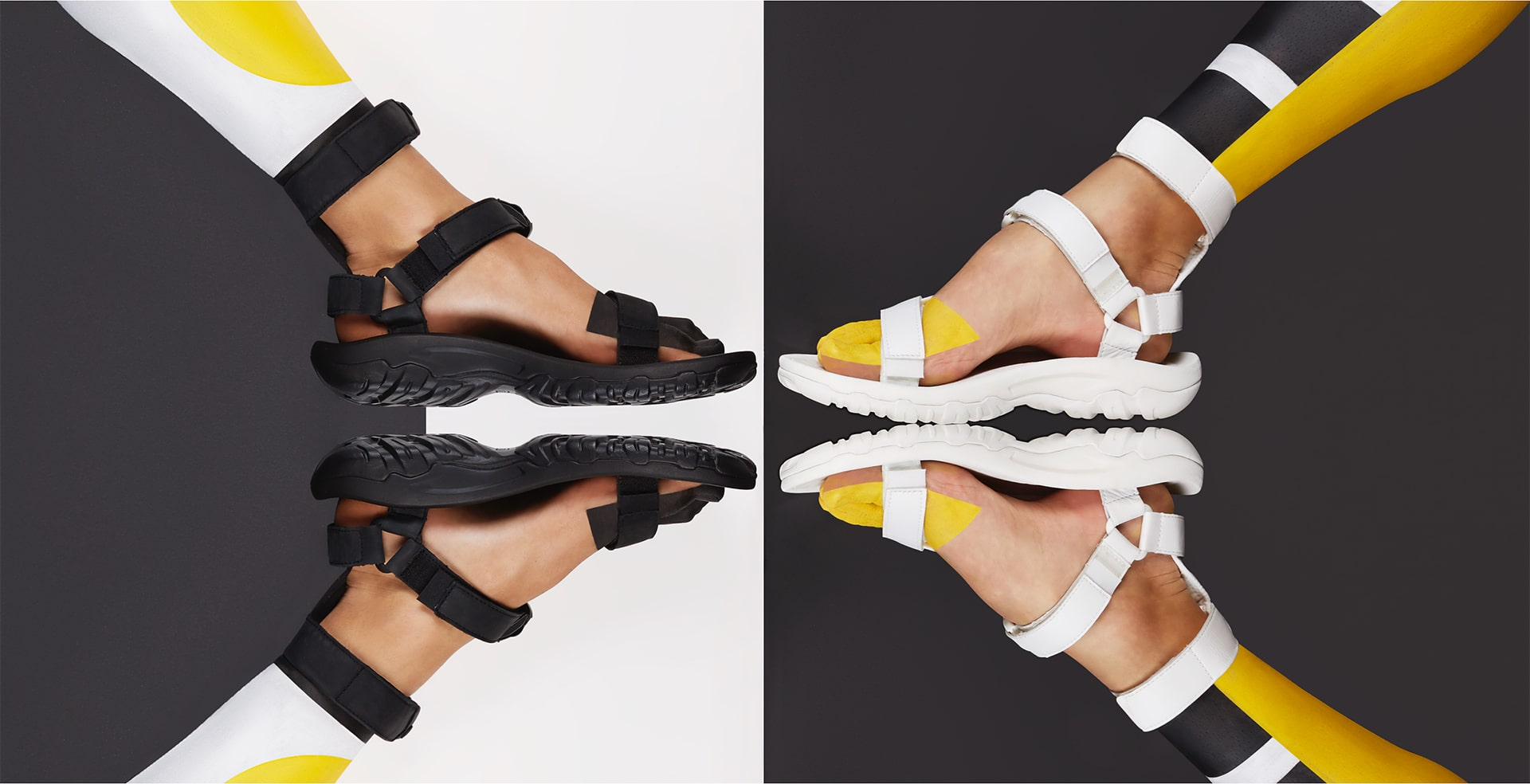Black Teva sandals over white and gray background.