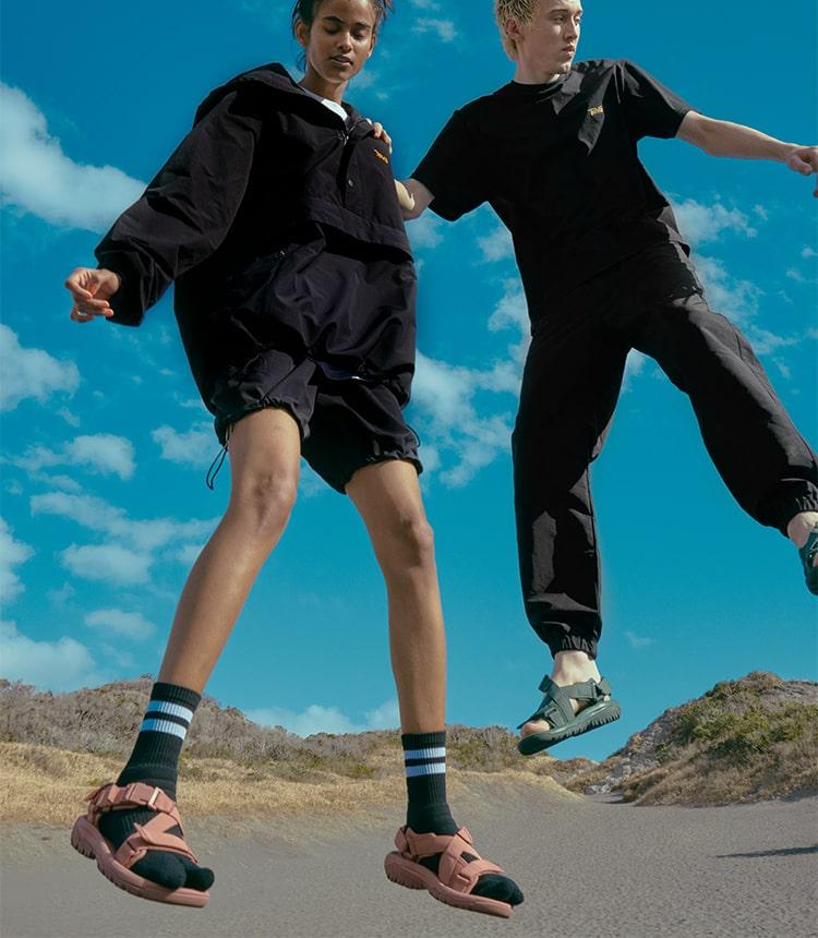 Teva x Cotopaxi windbreakers and sandals.